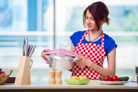 Photo for Woman preparing soup in the kitchen - Royalty Free Image