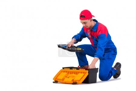 Photo for Young repairman with wrench spanner isolated on white - Royalty Free Image