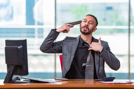 Photo for Desperate broke man committing suicide in the office - Royalty Free Image