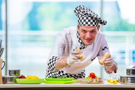 Photo for Male cook preparing food in the kitchen - Royalty Free Image