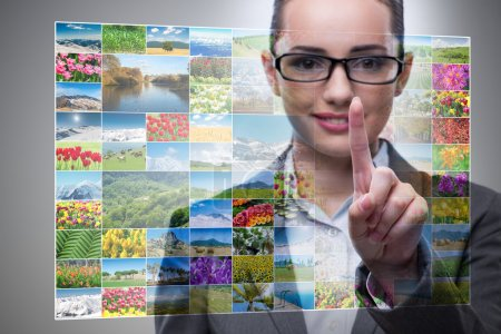 Businesswoman pressing virtual button on nature collage