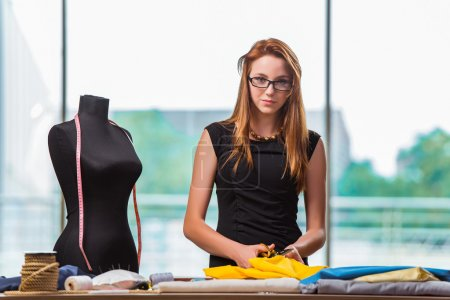Photo for Woman tailor working on new clothing - Royalty Free Image