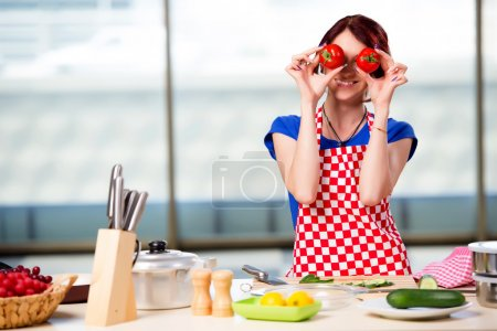 Photo for Woman preparing salad in the kitchen - Royalty Free Image