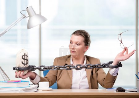 Woman chained to her working desk