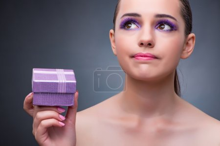 Young woman receiving small giftbox