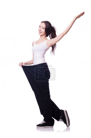 Young girl in weight control concept isolated on white