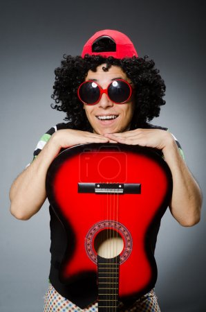Photo for Man with funny haircut and guitar - Royalty Free Image
