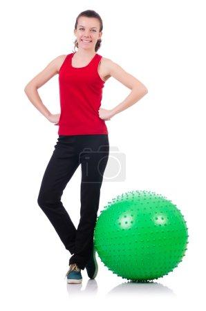 Photo pour Jeune femme faisant de l'exercice avec balle suisse - image libre de droit