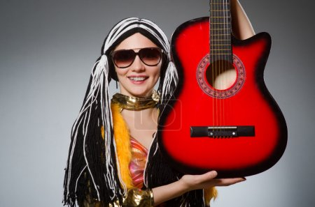 Photo for Guitar player with red instrument - Royalty Free Image