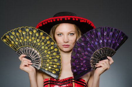 Woman dancing with fans