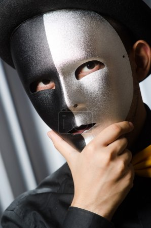 Man with theatrical mask