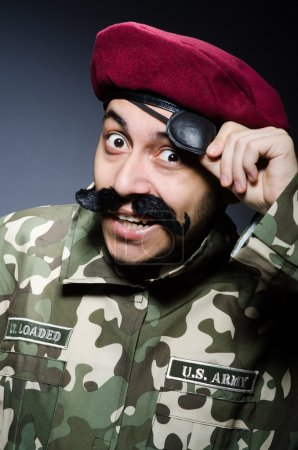 Photo for Funny soldier in military concept on grey background - Royalty Free Image
