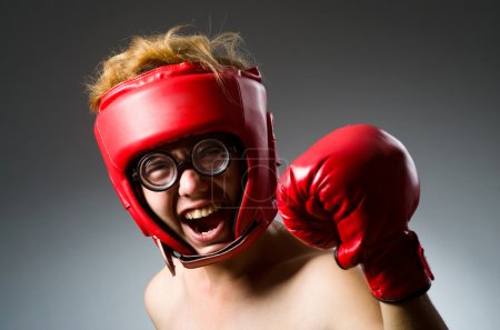 Funny boxer on dark