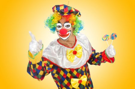 Photo for Clown with lollipops isolated on white - Royalty Free Image