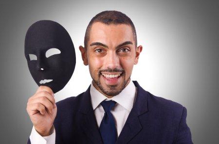 Photo pour Homme avec masque noir isolé sur blanc - image libre de droit