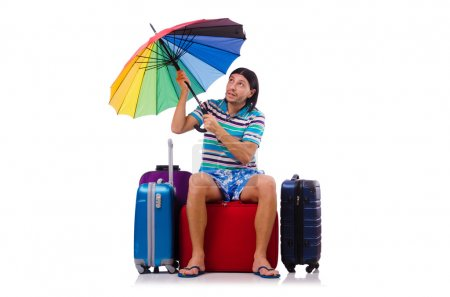 Photo for Traveler with cases and umbrella isolated on white - Royalty Free Image