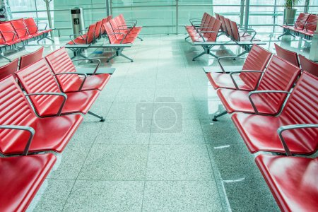 Photo for Red Chairs in the airport lounge area - Royalty Free Image