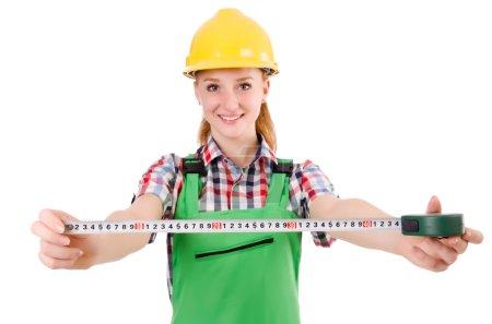 Female handyman in overalls
