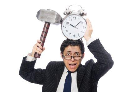 Foto de Empresario sosteniendo martillo y despertador aislado en blanco - Imagen libre de derechos