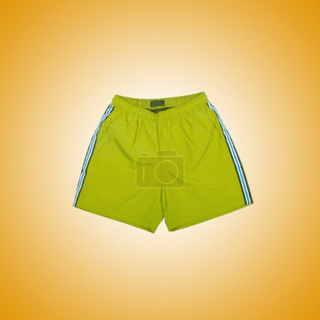 Photo for Sport Male shorts against yellow gradient background - Royalty Free Image