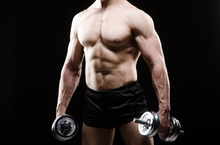 Photo for Muscular ripped bodybuilder with dumbbells - Royalty Free Image