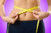 Woman in bikini in diet concept