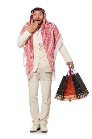 Photo pour Arabe homme avec des sacs à provisions sur blanc - image libre de droit