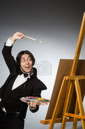 Photo for Funny artist in dark studio - Royalty Free Image