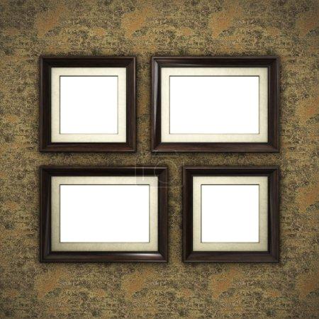 Wooden frames on color wallpaper