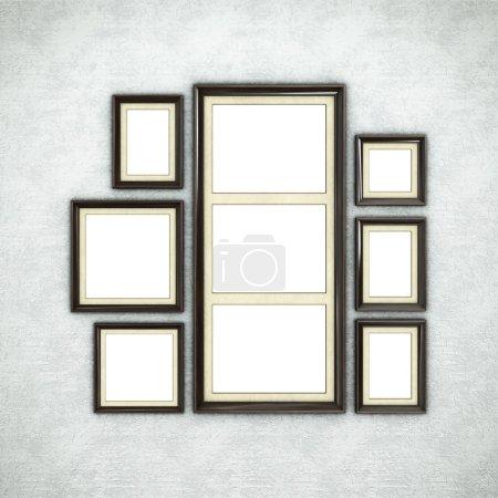 Wooden frames on wallpaper