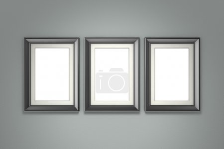 Black picture frames on gray wall