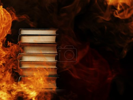 Stack of books in  burning fire