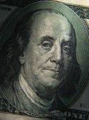 Benjamin Franklin's portrait is depicted on the  1