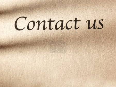 """inscription """"contact us"""" on  paper."""