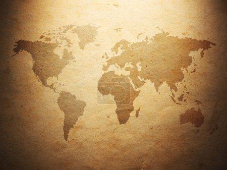 Photo pour Carte du monde affichée sur le vieux papier ondulé. Gros plan - image libre de droit