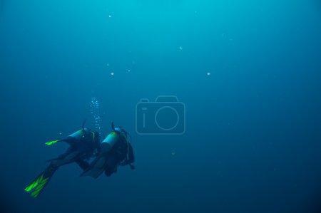 Couple of scuba divers  on underwater