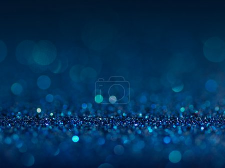 Defocused abstract blue lights background .