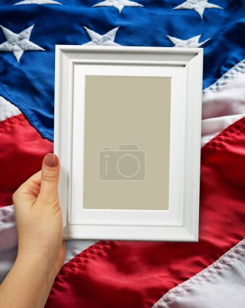 Wooden frame in woman hand