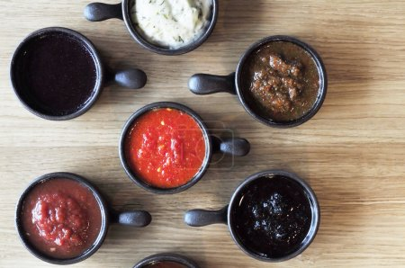 variety of sauces in cups