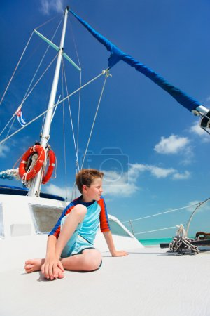Little boy at luxury yacht