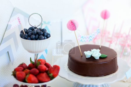 Blueberries, strawberries, grapes and a chocolate ...