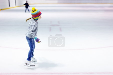 Little girl ice skating