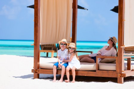 Photo for Happy beautiful family relaxing at beach during summer vacation - Royalty Free Image