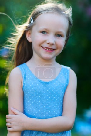 Photo for Casual portrait of little girl outdoors on summer day - Royalty Free Image
