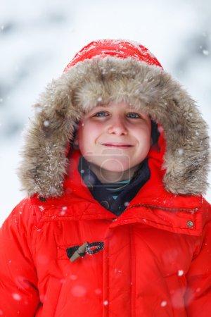 Cute boy outdoors on winter