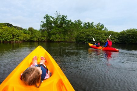 Family kayaking in mangroves