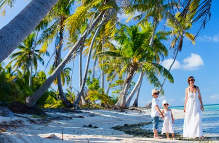 Mother and kids on a tropical vacation