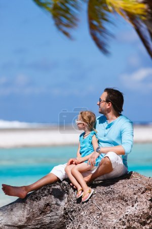Father and daughter on a beach vacation