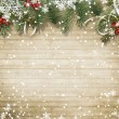 Vintage wood texture with snow, holly and firtree...