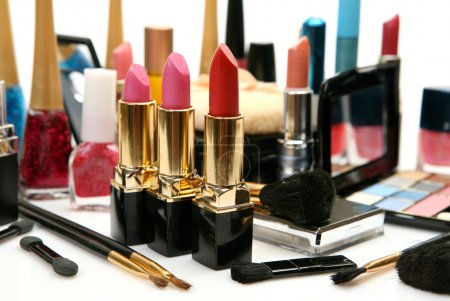 Decorative cosmetics with lipsticks on white backg...